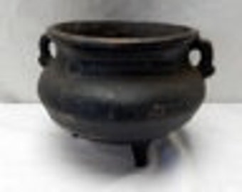Three footed Cast Iron Pot