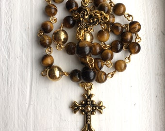 Anglican prayer beads, tigereye and brass beads, gold tone pewter cross and connector