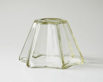 Star shaped jelly mold in thick depression glass