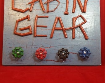 CABIN GEAR SIGN Hand Crafted Salvaged Board with Vintage Faucet Handles holds all kinds of personal gear