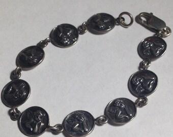 Sterling silver cherubs bracelet 7 inches in size