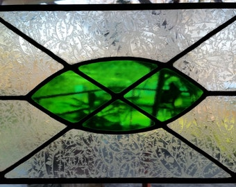Leaded stained glass panel. Clear glue chip with green center. Sun catcher.