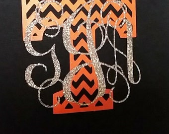 Monogram front of shirt, cheveron initials