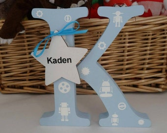 Wooden letter K in blue with Robots
