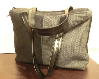 bag with different fabrics and handles made of genuine leather