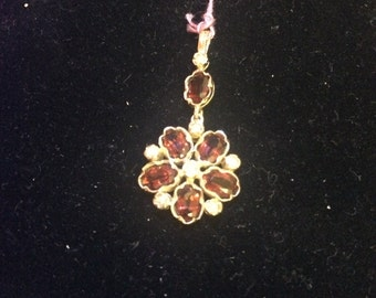 Gold, garnet and pearl pendant.
