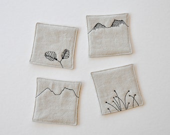 Cradle Mountain, Tasmania coasters. Set of 4 natural linen, fabric coasters. Machine-stitched quilted motif. Reversible yellow back