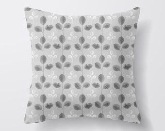 grey and white cushion, made from 100% cotton comes stuffed with feather inner.