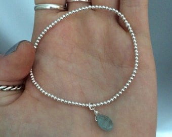 Sterling Silver stacker with aquamarine stone detail