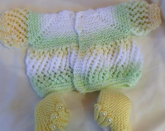 Knitted baby sweater and booties