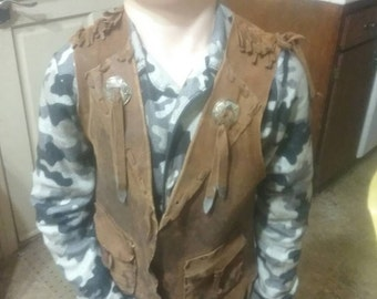 Leather or buckskin shirt or vest--you supply materials and I'll make it to fit you, the style you want.