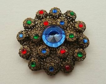 Colored stone brooch