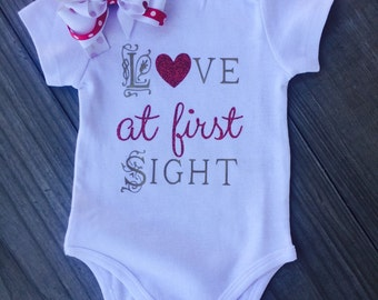 Love at first sight shortsleeve onesie. Gold with red glitter. Bow not included.