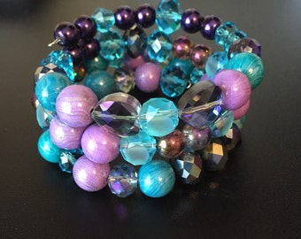 Purple and turquoise wrapped bracelet with memory wire and handmade polymer clay beads from Kidalia