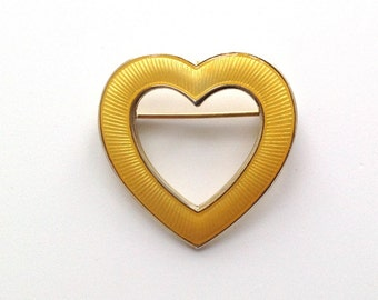 A vintage Aksel Holmsen yellow enamelled silver brooch