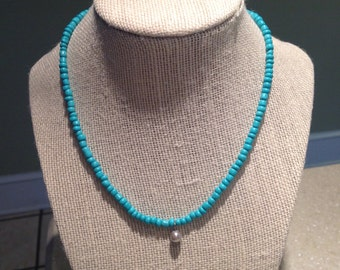 Turquoise necklace with single pearl