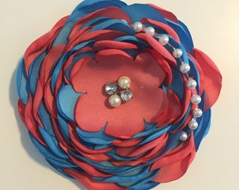 Singed flower clip or headband