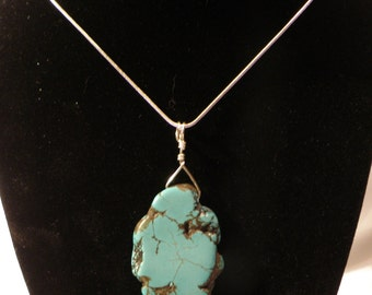 Turquoise pendant on a 20 inch snake chain