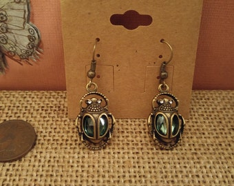 Antique bronze with green glass scarab earrings