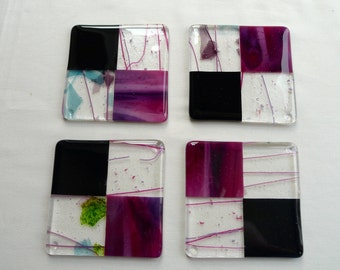 A set of 4 fused glass coasters