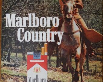 Marlboro Man ad.  1972 Marlboro Man cigarette ad.  Marlboro Man on Horseback. Life Magazine.  August 11, 1972.