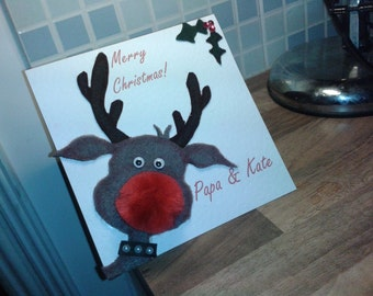 Christmas Card: Rudolph the red-nosed reindeer has a fluffy nose