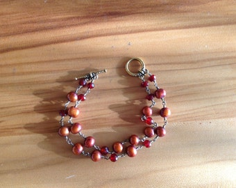 Bracelet red freshwater pearl and carnelian wire wrapped with gold