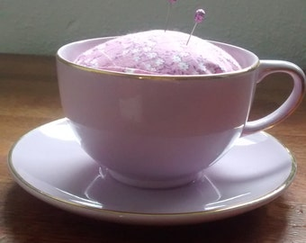 Teacup pincushion with two glitter head pins