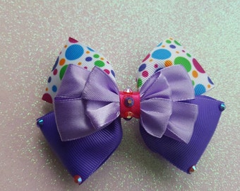 Mismatched spots and dots hair Bow.