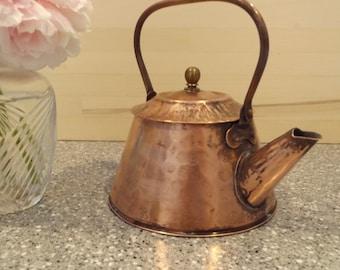Hammered-top copper teakettle