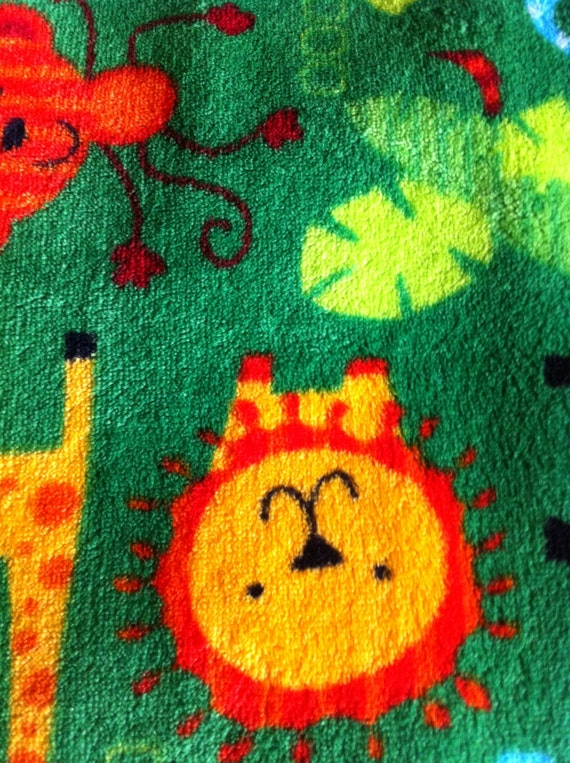 Cuddle aminal print fabric fleece lions elephants moneys for Fleece fabric childrens prints