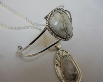 White Buffalo Turquoise Cabochons set in Sterling Silver.
