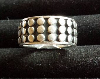 Heavy sterling silver band decorated with a bobble pattern. Size S 1/2