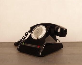 Vintage black phone, bakelite, ca 1950.