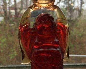 Buddha,amber colored translucent solid resin buddha