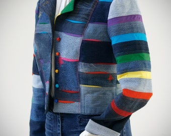 Ladies' multicoloured, cropped, pieced top stitched plus sewn text denim jacket. Top stitched, sewn text