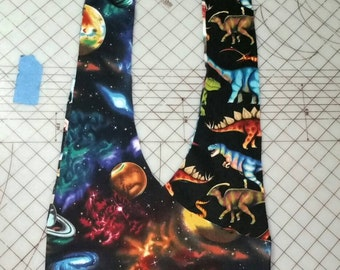 Dinosaurs in space reversible purse