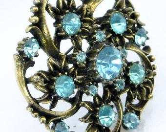 Vintage CORO  Brooch, 1940's Designer round aqua blue rhinestone, antiqued gold tone swirl pin