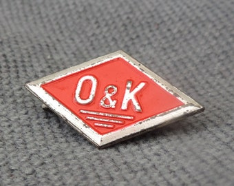 Vintage O and K brooch, white metal and red enamel.