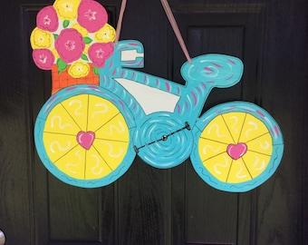 Wooden bicycle door hanger