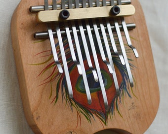"Kalimba ""Lightness"" (artwork of Ziedune) (Thumb piano, music instrument, meditation instrument, feather, digital print)"