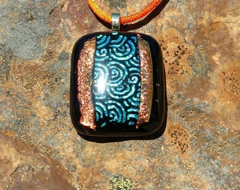 Dichroic Fused Glass Pendant, Black with Shimmering Orange and blue-green swirls, Handmade Necklace