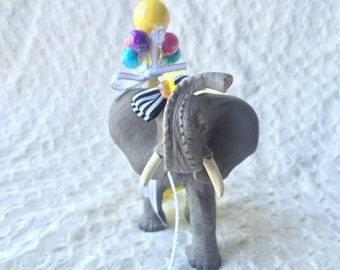 Elephant decorated plastic animal party centerpiece or cake topper