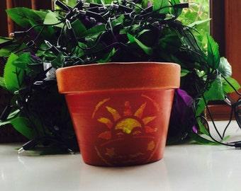 Decorated terracotta pot