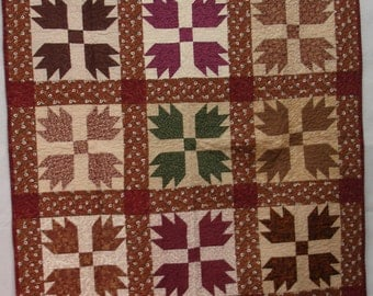 Vintage quilt bear paw design