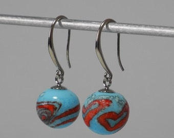 Earrings sleepers, glass beads spun, spiral and random hearts orange on blue sky, surface porous satin effect