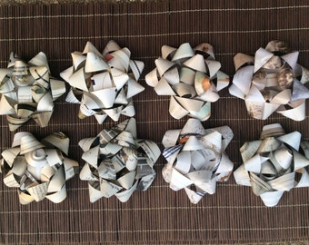 eight neutral toned, recycled gift bows