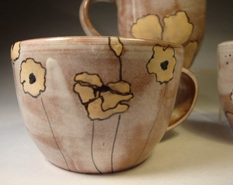 Hot tea cup with warm designs
