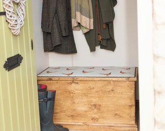Solid Blanket chest upholstered in country pheasant fabric