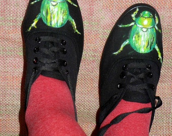 Hand-painted black trainers with beetle